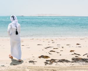 Middle Eastern Man by the beautiful water in the desert of Doha, Qatar