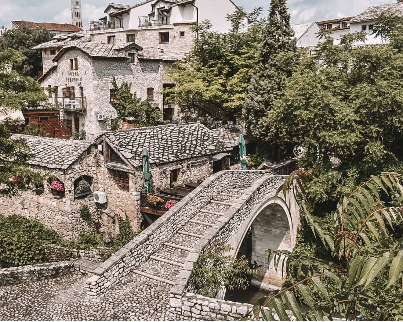 All you need is one day to be welcomed by the locals and discover the historic charm of Mostar. Here's why you should visit Mostar, Bosnia and Herzegovina. | #mostar #bosniaandherzegovina #balkantour #balkans
