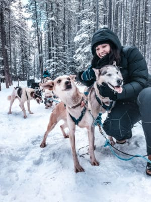 It's the quintessential Canadian adventure, dog sledding in Alberta Canada- home of the Canadian Rockies. If you are planning a winter vacation, or holiday to Banff, Lake Louise, or Canmore, you must add dog sledding to your winter activity list! Perfect for all travellers, backpackers, solo travellers, families! #winter #canada #banff #dogsledding